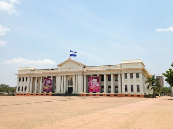 The National Palace with the Nicaraguan flag waving in the wind.
