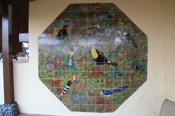 Colorful bird themed tiled artwork on the terrace.