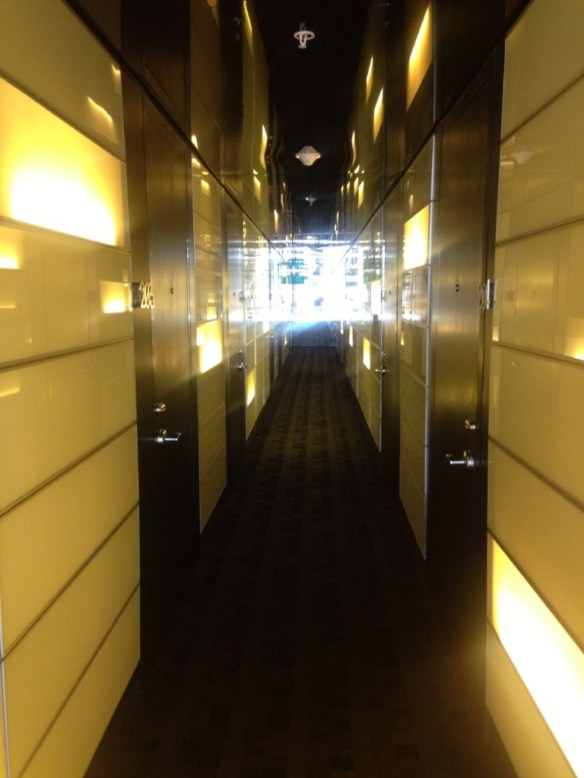 Hallway to the room. Looks like a music video set.