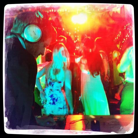 Photo of David DJing with people dancing
