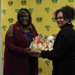 Dawn Lindo-Morgan receiving her Jewel Isle Rum Punch hamper from Tropical Sun's Vaseva Qarau. Photo courtesy CaribDirect