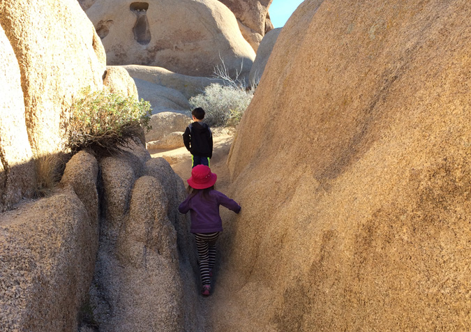 Squeezing through boulders near Jumbo Rocks