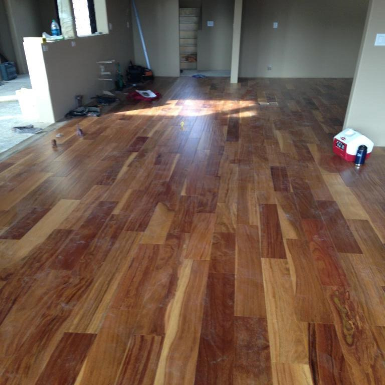 Kitchen and Dining room floor gets wood laid.