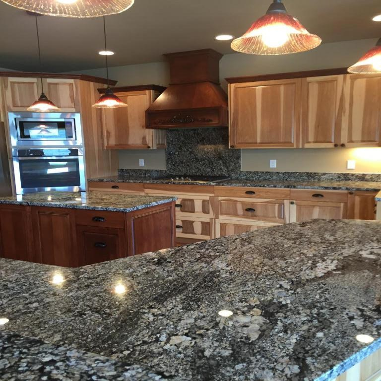 Kitchen countertops granite shiny and ready for move in