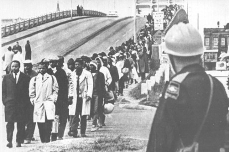 Martin Luther King leads the march for civil rights over the Selma, Alabama Edmund Pettus Bridge, 1965.