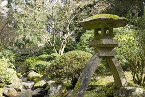 9210626-Stone-Lantern-by-the-Creek-at-Portland-Japanese-Garden-Stock-Photo