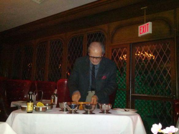 Felix Rinaldi prepares Caesar salad dressing by hand.