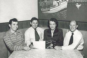 "Anthony's founders, 1946 - L to R: Anthony Ghio, Tod Ghio, Catherine ""Mama"" Ghio, and Roy Weber - photo by Anthony's Fish Grotto"