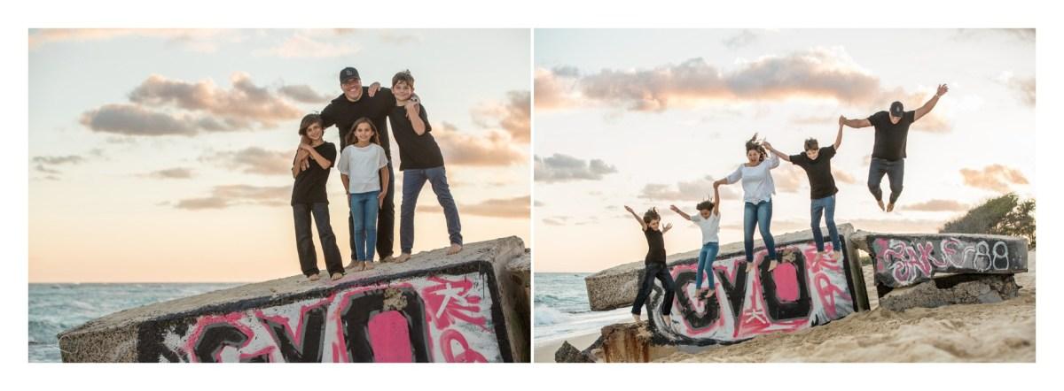 Family jumping on beach in Ewa Beach Hawaii