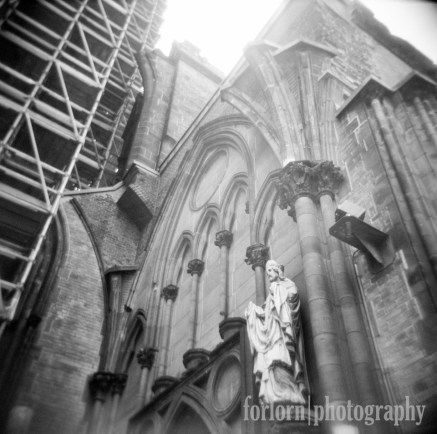 This was about the most attractive view of the church at the moment. I gotta return after they're done with the renovation. Camera: Holga 120N Film: Kodak Tri-X