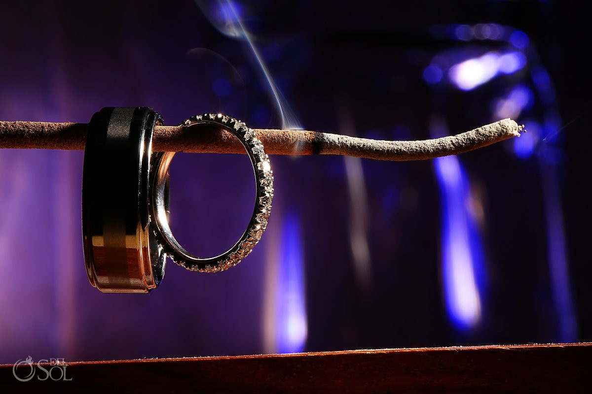 best engagement wedding rings purple wedding rings Riviera Maya wedding rings on an incense stick with smoke