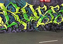 LET'S GET PHYSICAL: Gabe Subry, owner of CrossFit 209, above, stands by large mural in his facility PHOTO BY FRANCINA SANCHEZ