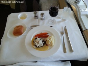steak and lump crab meat dinner 1st class lufthansa 747-8 delta points blog