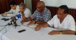 Second from left: President of GAWU, Komal Chand; NAACIE President, Kenneth Joseph and GAWU General Secretary, Seepaul Narine.