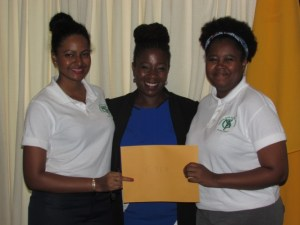 Representatives from the Caribbean Youth Environment Network flank CSR Manager Ayaana Jean-Baptiste