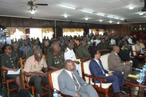 Top government ministers (front row) and officers of the Guyana Defence Force listen to the opening address by President David Granger at 2016 GDF Annual Officers' Conference.