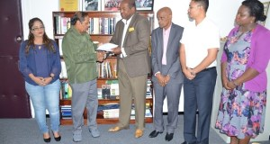 Prime Minister Moses Nagamootoo receives the final report from Convenor of the Steering Committee on Constitutional Reform, Nigel Hughes. Also in photo are the other members of the committee.