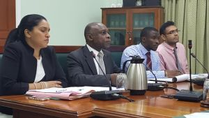 Minister of Foreign Affairs, Carl Greenidge (centre) flanked by technical officers at the Foreign Relations Sectoral Committee meeting that examined the status of the Guyana-Brazil Partial Scope Agreement.