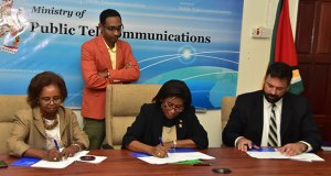 """An Information Communication Technology (ICT) needs assessment project will get underway in hinterland and rural communities in Guyana, following a US$524,00o contract which was signed among the Government of Guyana, Germany-based Detecon Consultancy and the United Nations Development Programme (UNDP). Present at the signing today, was Resident UNDP Coordinator, Khadija Musa who co-signed the agreement alongside Minister of Public Telecommunications, Catherine Hughes and Stephan Dieter, Detecon International representative.  Titled """"ICT Access and e-Services for Hinterland, Poor and Remote Communities"""", the project is a starting point ICT study to find out among other things, what infrastructure, technical capacity, and legal framework are already there in poor, remote and un-served areas in Guyana. During brief remarks Minister Hughes pointed out that for many years Guyana has been lagging behind the rest of the developing world because of the lack of technological resources to meet the demands and standards in almost every field of endeavour, for every service and product. Minister Hughes said that the needs assessment project is a very important one, which allows Government to start an evaluation of the country's ICT needs. The project will be out for funding to the Guyana Redd+ Investment Fund (GRIF). (Guyana Chronicle photo)"""