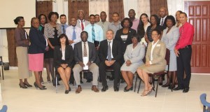 Newly appointed Commissioner General of the Guyana Revenue Authority, Godfrey Statia (seated third from right) and Chairman of the Governing Board, Rawle Lucas next to him.