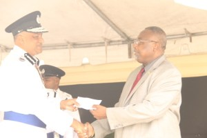 Police Commissioner, Seelall Persaud presenting a GYD$2.7 million cheque to the Chairman of the Fallen Heroes Foundation, Pastor Raphael Massiah.