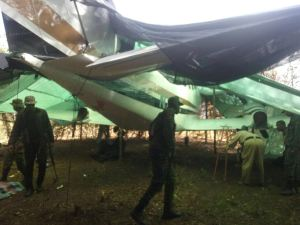Police and soldiers inspecting the illegal Cessna plane that was found at Yupukari, Rupununi.