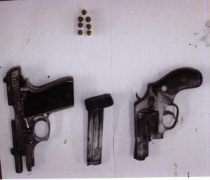 Guns and ammunition found by police during their probe into the murder of Ryan Sargeant outside Rio Inn.