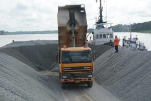 Grassalco, a Surinamese company, loading crushed stone on a barge.