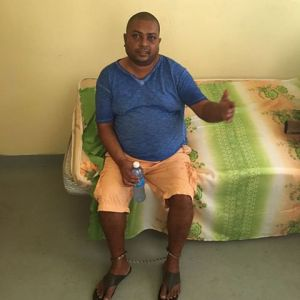 SHACKLED: Barry Dataram in custody following his arrest in a house at Latour, southern Paramaribo.