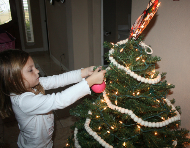 emma decorating her tree