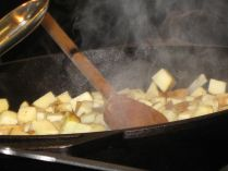Cooking potatoes on cast iron.