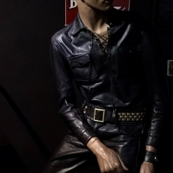 "A mannequin poses at the Museum's ""Leather Bar,"" outfitted in a standard leather uniform."