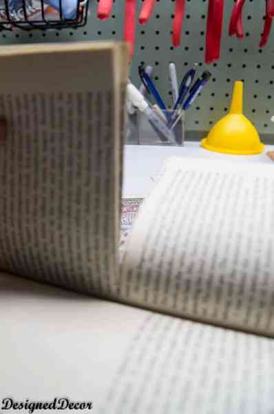 how to cut a book in half for a repurposed book flower