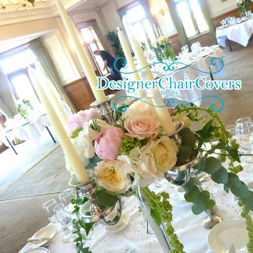 silver candelabra with flowers