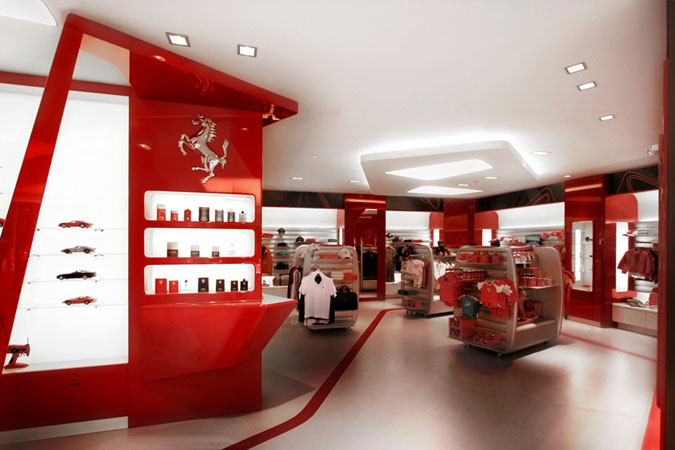 Retail   Interior Designers NYC   Designer Previews Ferrari red is the cohesive design element along with curvilinear lines for  displays  in the