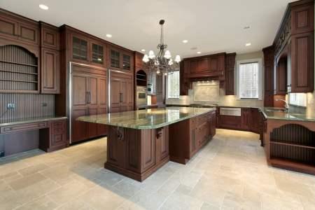 large custom kitchen dark wood green granite countertops
