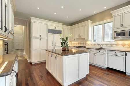 white cabinet kitchen with tile backsplash