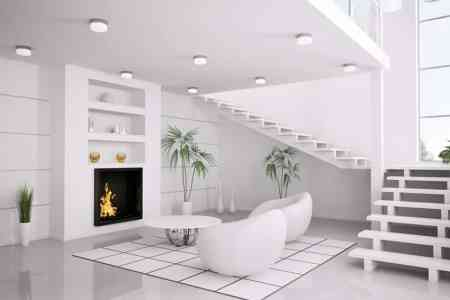 pure white modern living room with fireplace