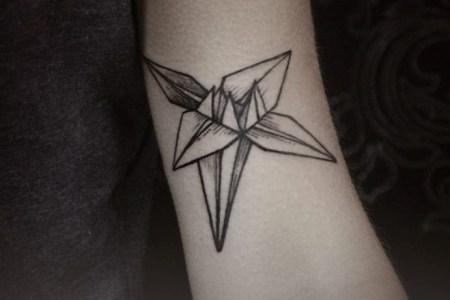 simple tattoo on arm by diana severinenko