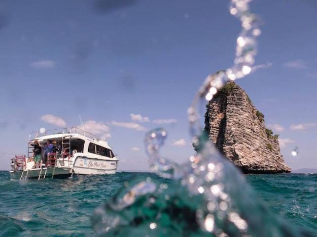 Dive boat and karst islet.