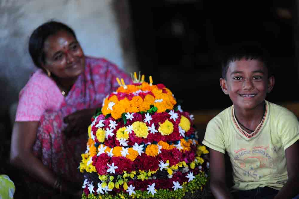 A Telangana woman and her son with Bathukamma