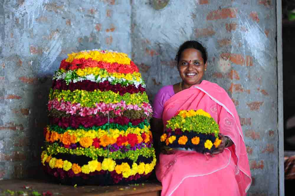a woman with Bathukamma