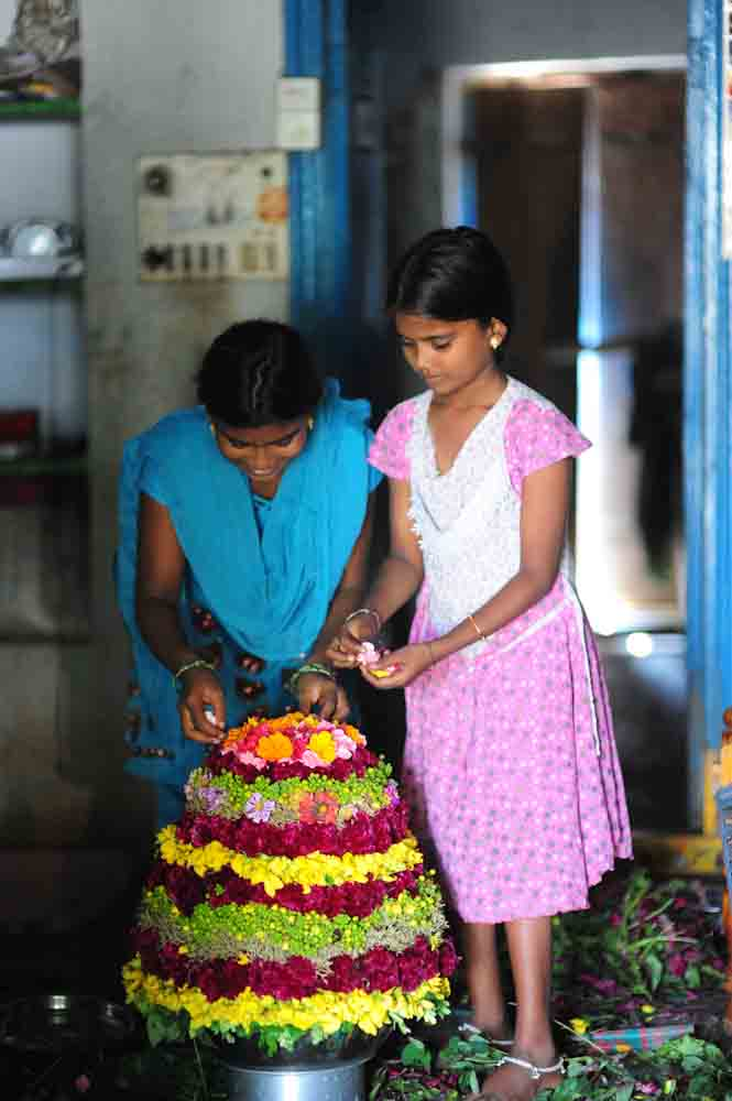 Girls making Bathukamma in Telangana