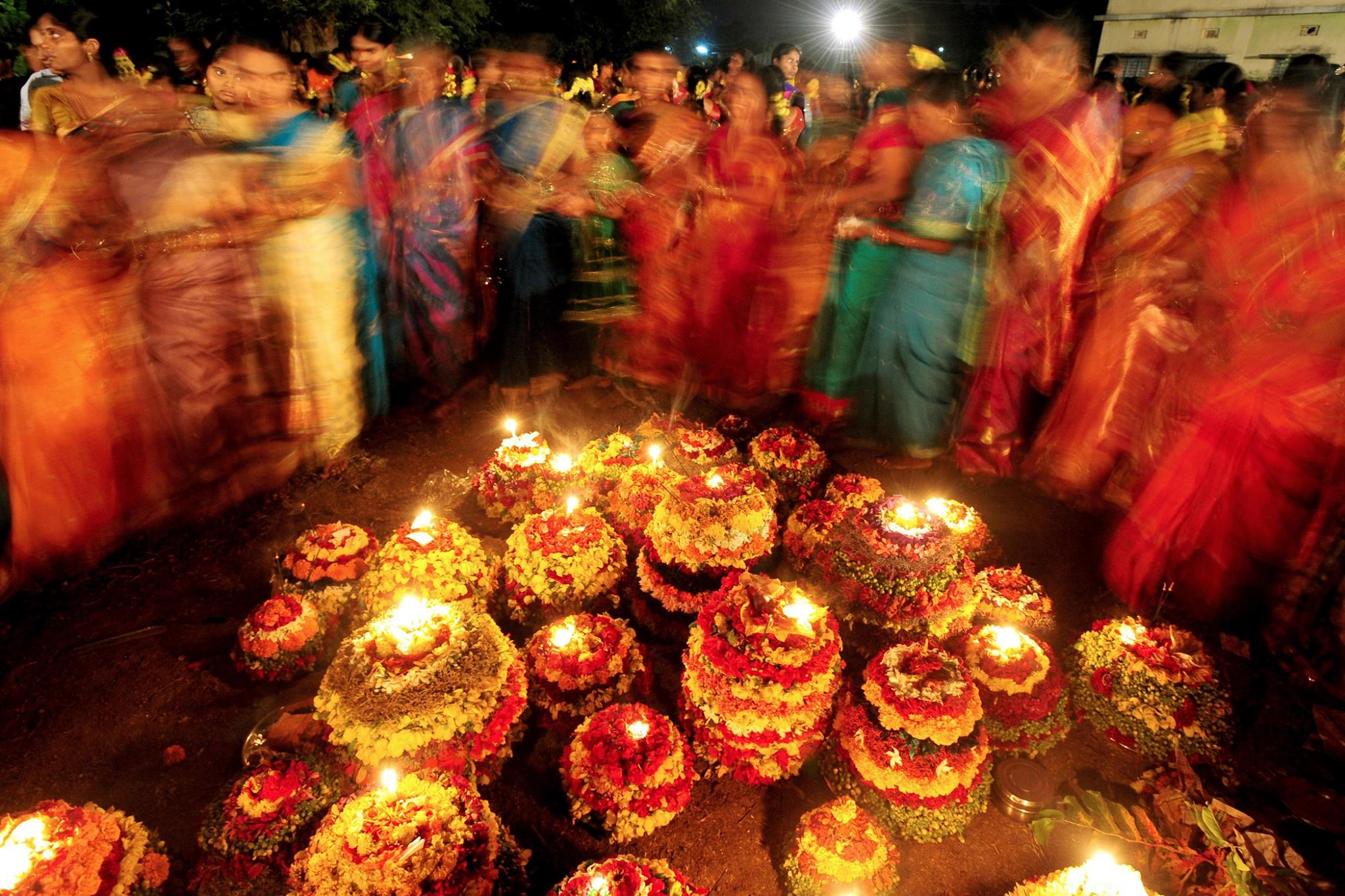 Women singing and dancing for Bathukamma celebrations