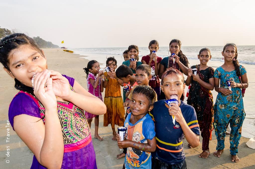 Kids enjoying ice-cream on a Goa Beach