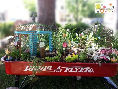 Fairy garden in little red wagon with Gypsy Garden by Genevieve Gail