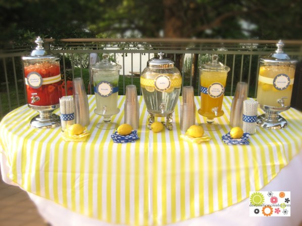 Flavored lemonade bar at wedding with polka dot straws and lemons.