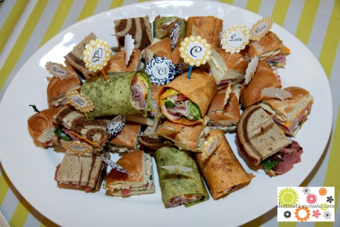 Wedding buffet-variety of wraps and mini sandwiches with DIY picks.