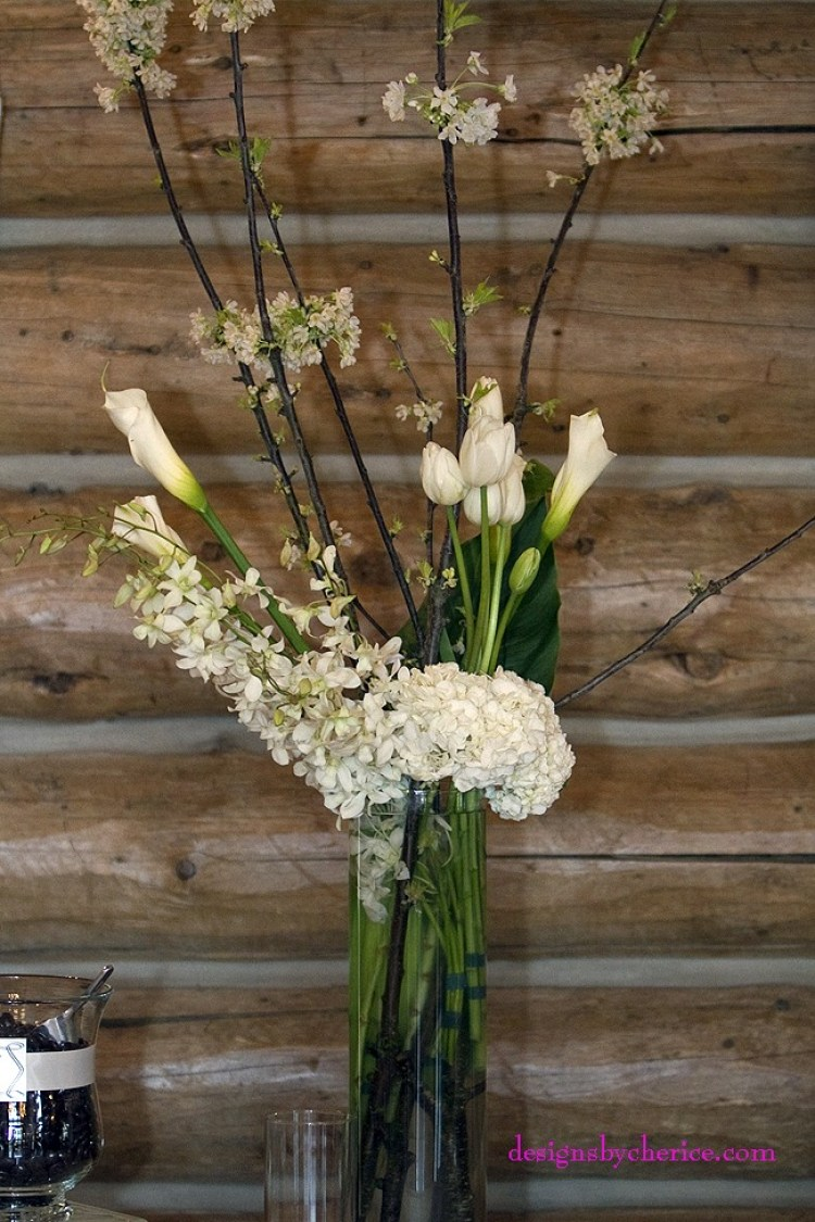 Flowering branches, tulips, large calla lilies, orchids and hydrangeas