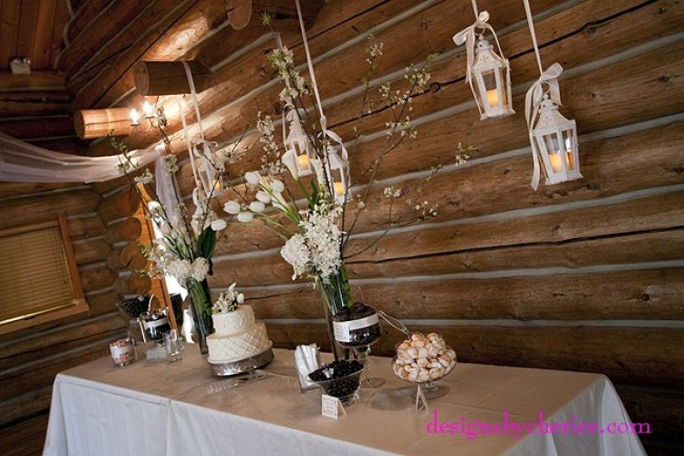 Rustic chic Colorado Mountain wedding tall white centerpieces with white lanterns